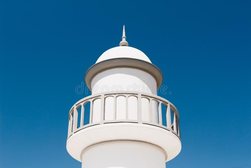 White Lighthouse Under Blue Sky stock image