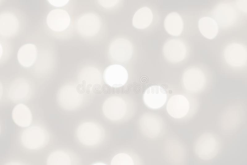 White lights bokeh blurred background, abstract beautiful blurry silver Christmas holiday party texture, copy space royalty free stock image