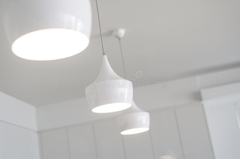 White lights in a new kitchen royalty free stock photos