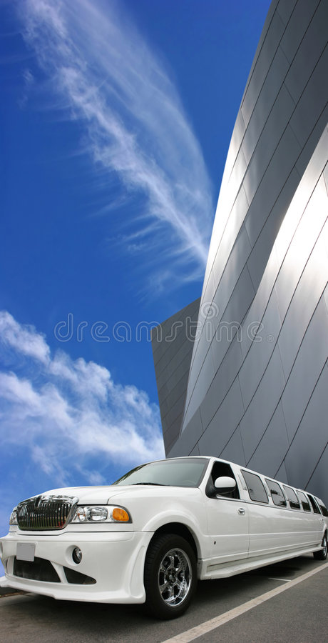 White limousine. And modern building royalty free stock photos