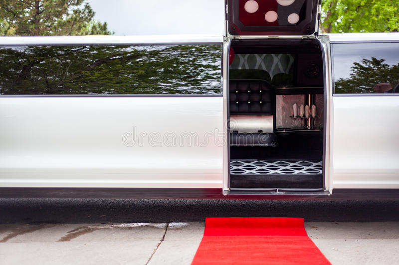 White limousine with inviting open door stock photos