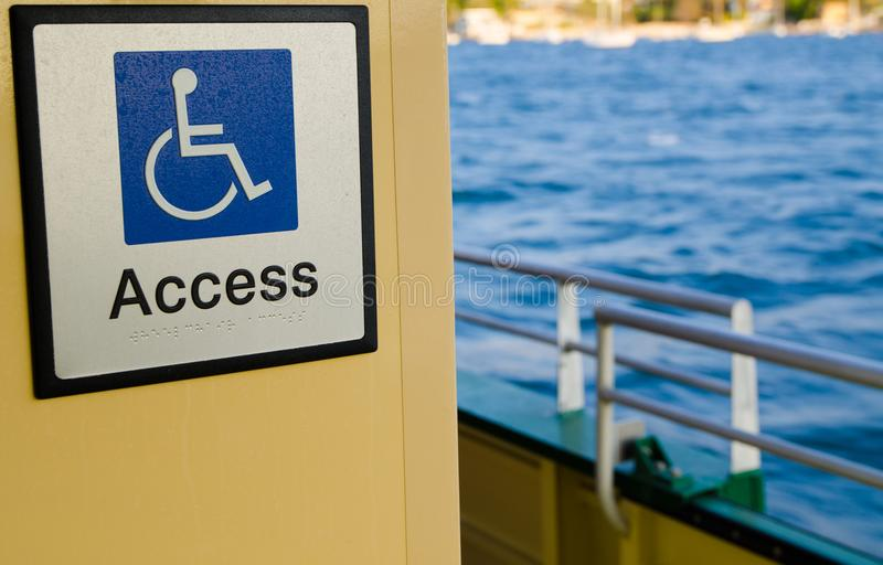 White line figure of a person seated over the axis of a wheel, blue background for wheelchair people Accessibility point. royalty free stock photo
