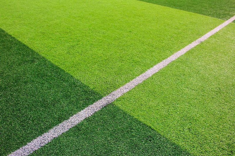 The white Line marking on the artificial green grass soccer field royalty free stock photos