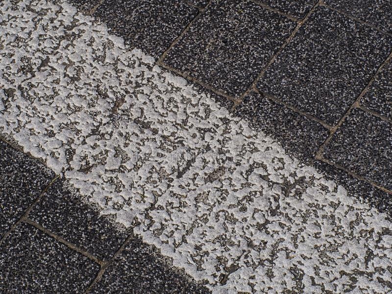 White line with paint on the road. Straight, highway, banner, tarmac, paved, textured, pavement, lane, freeway, pattern, dividing, transportation, motorway royalty free stock image