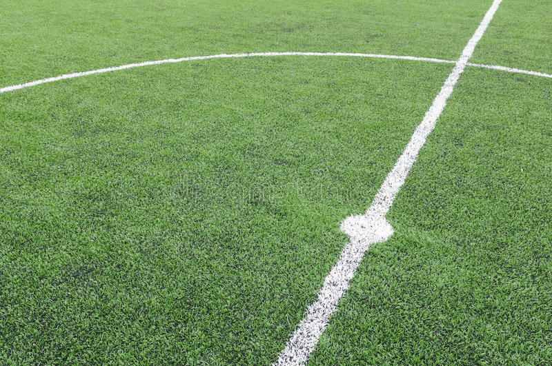 White line on a soccer field grass royalty free stock image