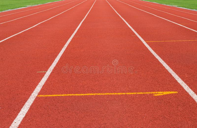 The white line on Synthetic Rubber Treadmill, Start point of run competition go to finish.  royalty free stock image
