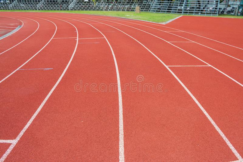 The white line on Synthetic Rubber Treadmill, Start point of run competition go to finish.  royalty free stock photo