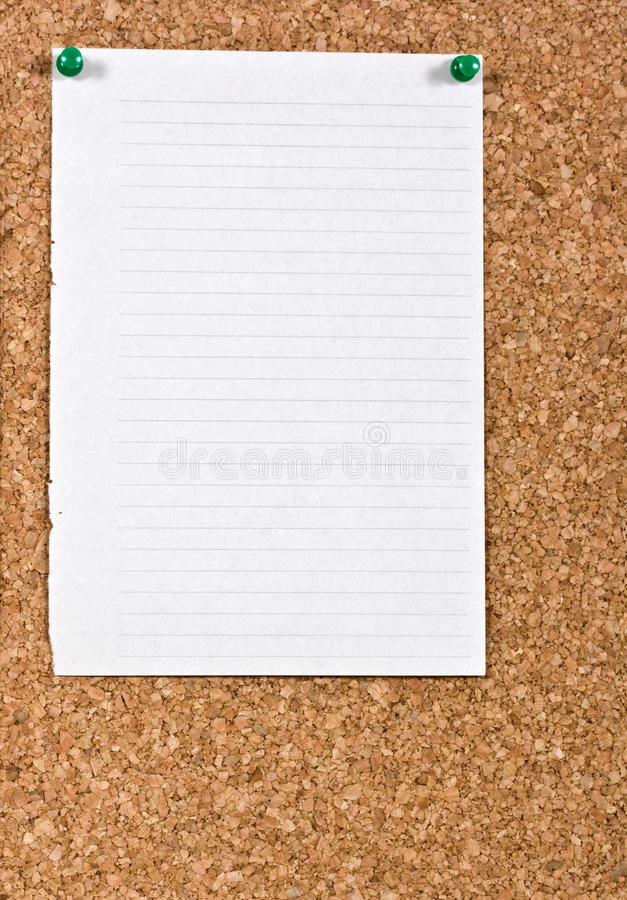White lined paper. Pinned to a cork notice board stock photos