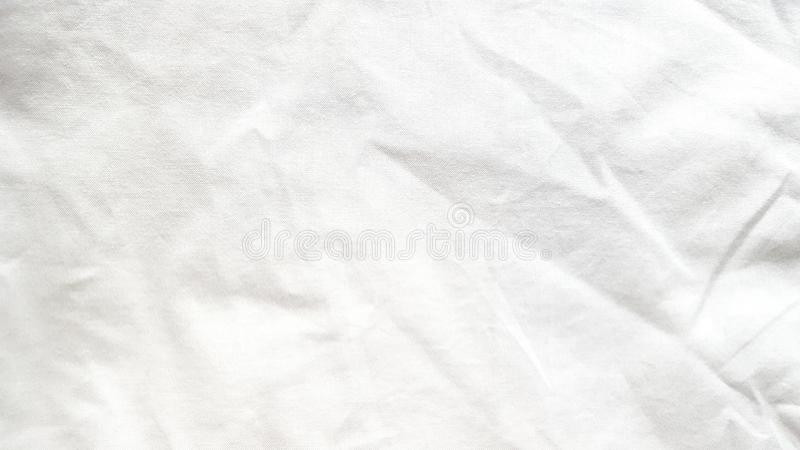 White linen fabric with wrinkle. White linen fabric background with wrinkle. The normal fabric suitable for many usage royalty free stock photos
