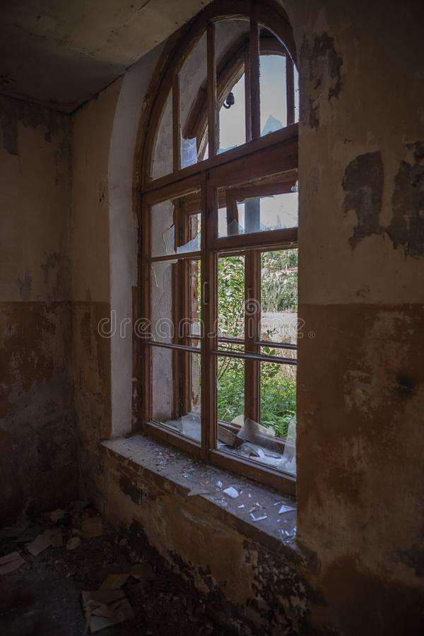 Old windows. White lit vintage, old window in an ancient white brick wall in an abandoned castle, interior with light from the windows, old windows with empty royalty free stock image