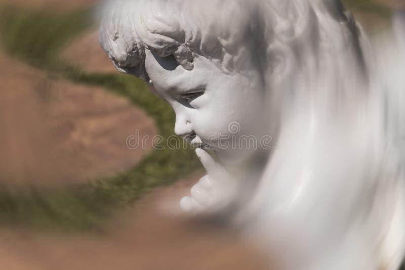 White  little angel sculpture stock photo