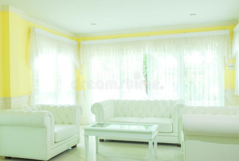 White living room with white furniture. Design of white living room with white furniture stock photo