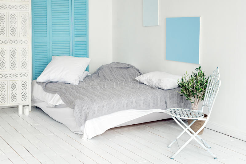 White loft interior in scandinavian style. Cozy area of apartment in nordic style, bedroom with white wood flooring stock image