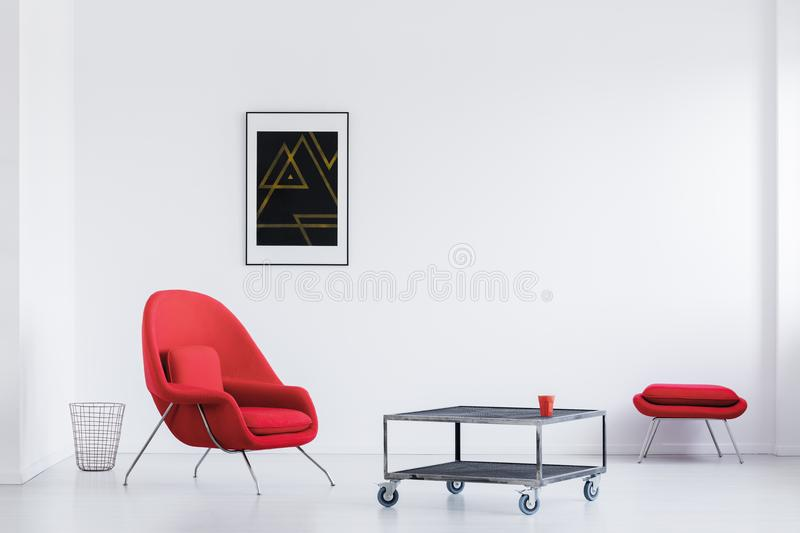White loft with red armchair stock photography