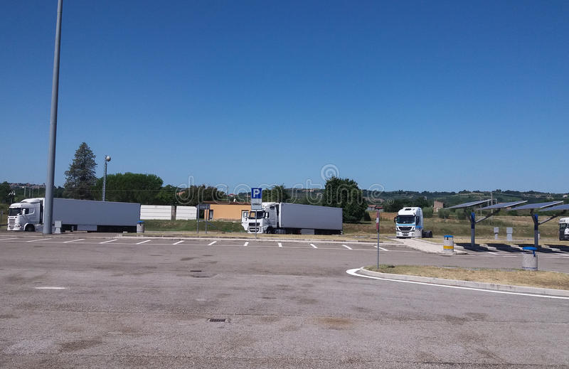 White lorry trucks. ROME, ITALY - CIRCA JULY 2016: white lorry trucks parked in service area stock photography