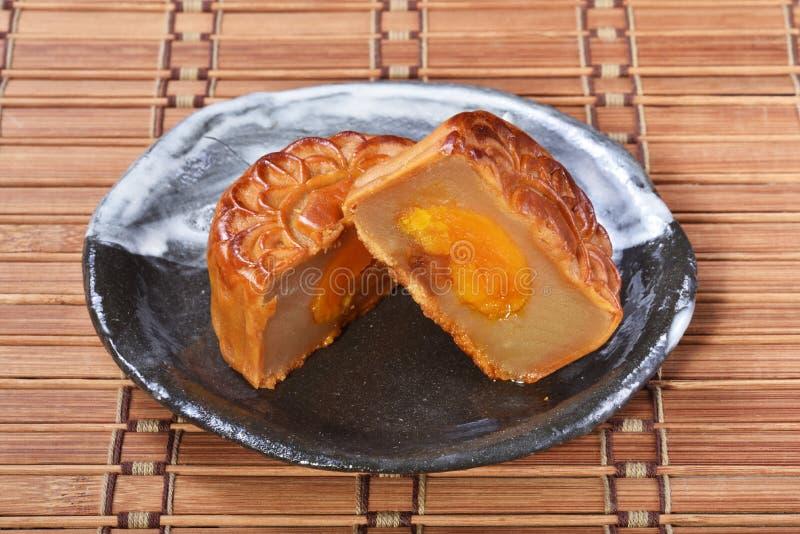 White lotus seed paste mooncake with egg yolk stock images