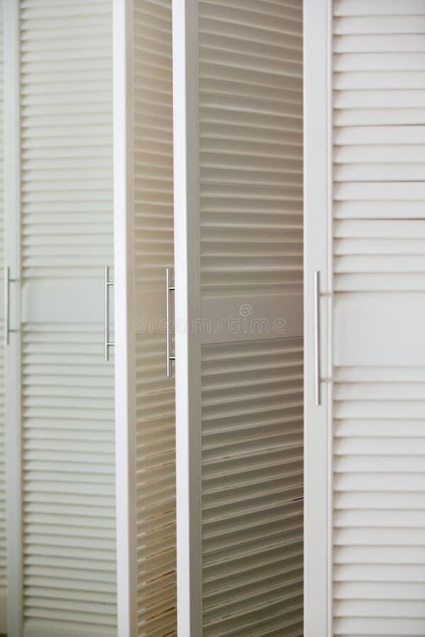 Download White Louvre Door Of Dressing Cabinet With Handle Stock Image - Image 76188327 & White Louvre Door Of Dressing Cabinet With Handle Stock Image ... pezcame.com