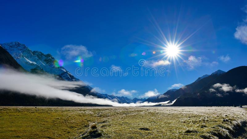 White low lying clouds and snow mountains in New Zealand royalty free stock photo