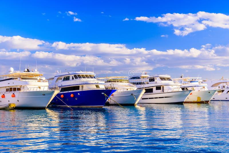 White luxury yachts in a sea harbor of Hurghada, Egypt. Marina with tourist boats on Red Sea royalty free stock photos