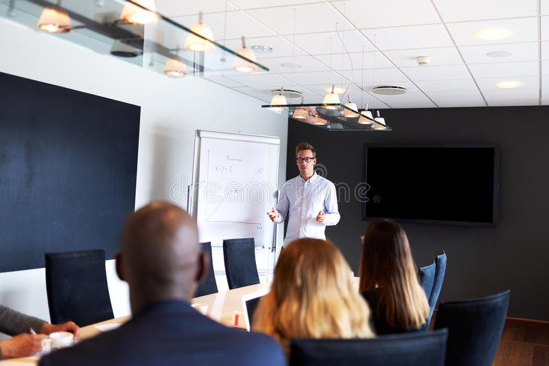 White male executive leading a work meeting stock photo