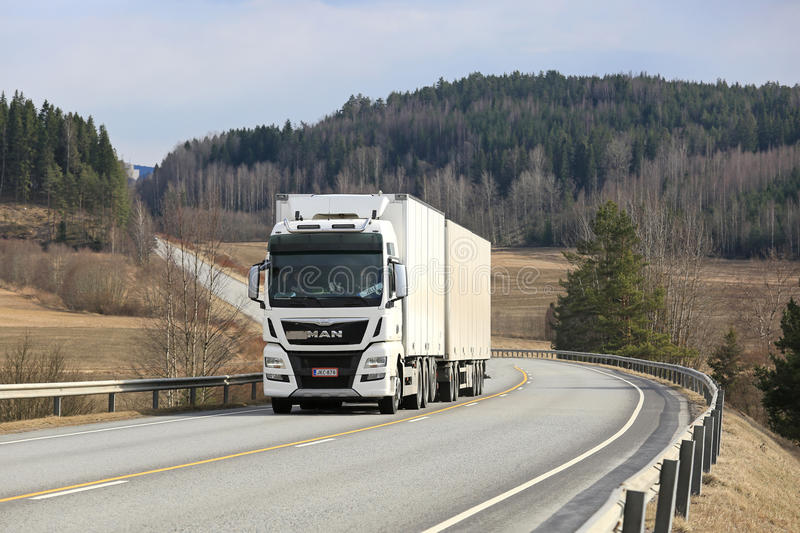 White MAN TGX D38 Cargo Truck on Scenic Road stock images