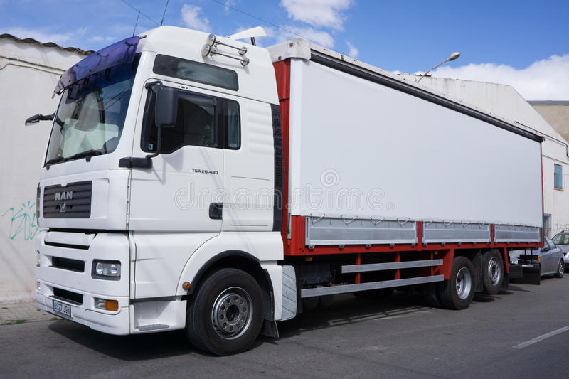 A White MAN Truck. VALENCIA, SPAIN - MARCH 10, 2016: A MAN Truck on the streets of Valencia. MAN Truck and Bus company is headquartered in Munich, Germany and is royalty free stock image