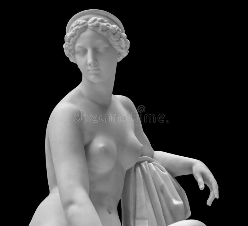 White marble sculpture head of young woman. Statue of sensual renaissance art era naked woman in circlet antique style. Isolated on black background stock photos