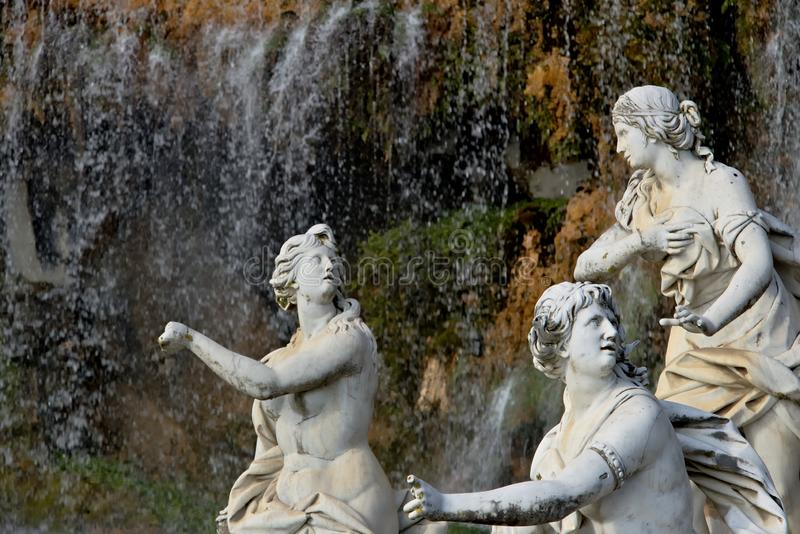 Reggia di Caserta, Italy. 10/27/2018. White marble sculptures under water cascade stock images