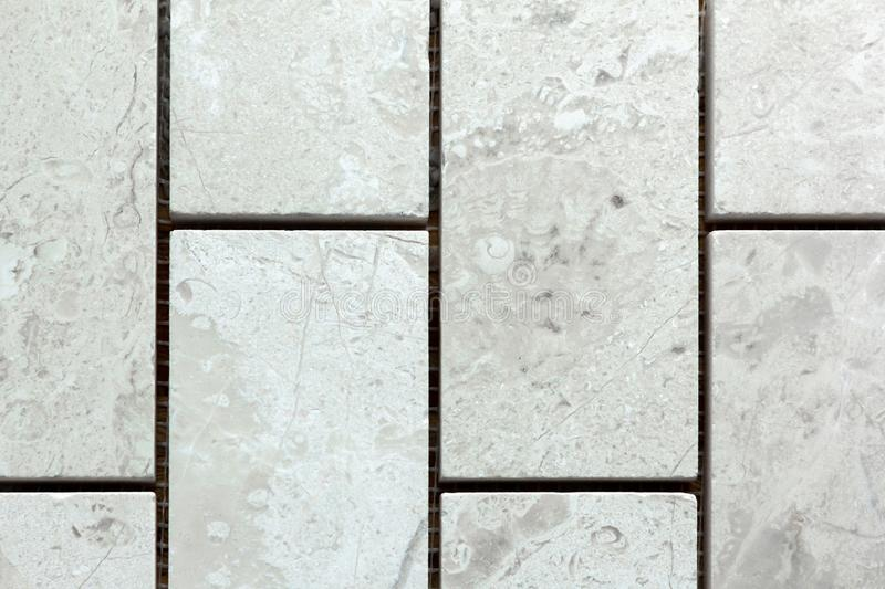 White marble from squares. As a background royalty free stock images
