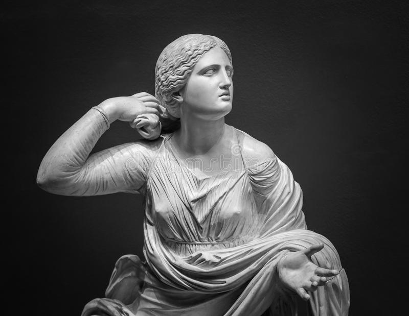 White marble statue of young woman.  stock image