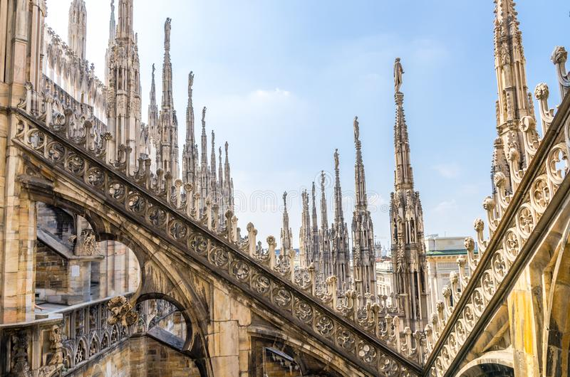 White marble statues on roof of Duomo di Milano Cathedral, Italy royalty free stock images