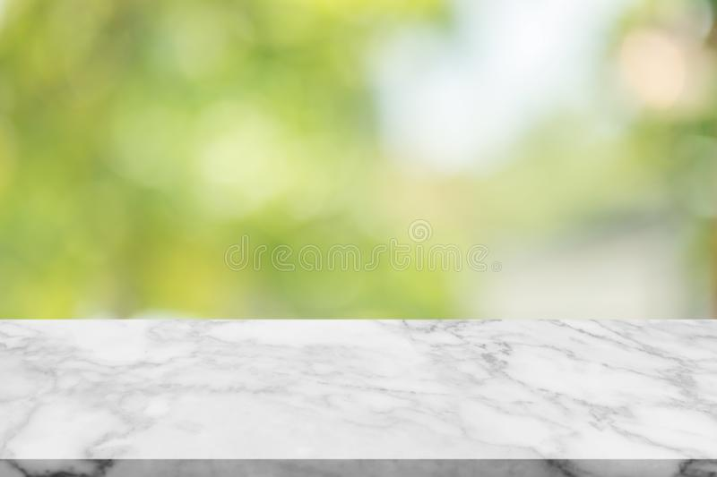 White marble stone table top on blur green background. White marble stone table top on blur green background from nature, can be used for display or montage royalty free stock photos