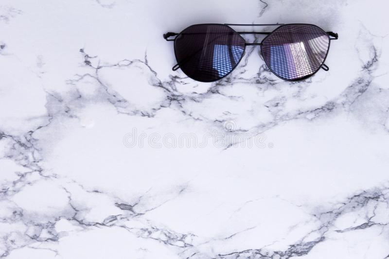 White marble texture with black sunglasses shadow and background for design pattern artwork, modern concept of natural organic stock photo