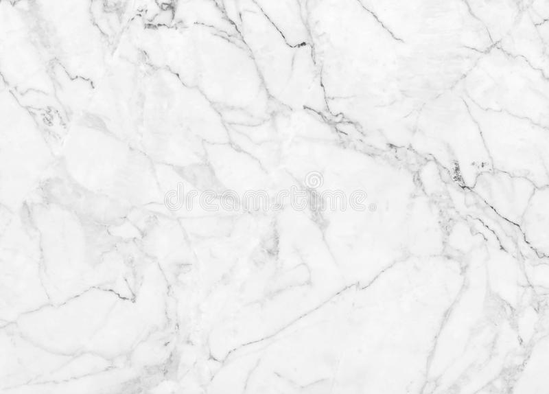 White marble texture with natural pattern for design art work. The White marble texture with natural pattern for design art work royalty free stock photos