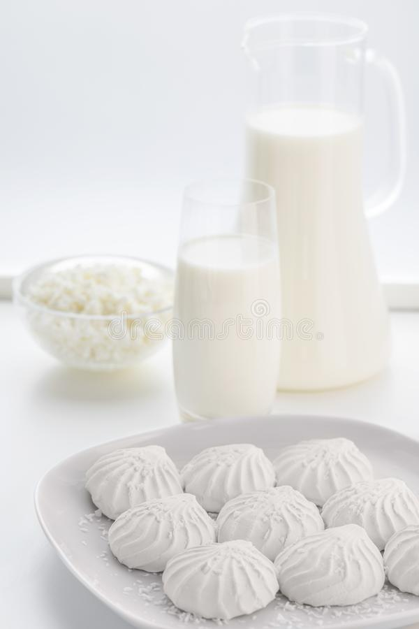 White marshmallow and milk in a jug stock photography