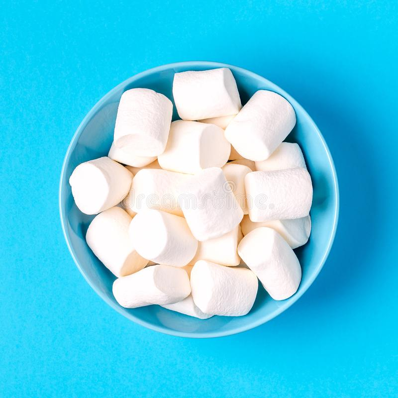 White marshmallows for roasting and hot chocolate in a bowl royalty free stock photography