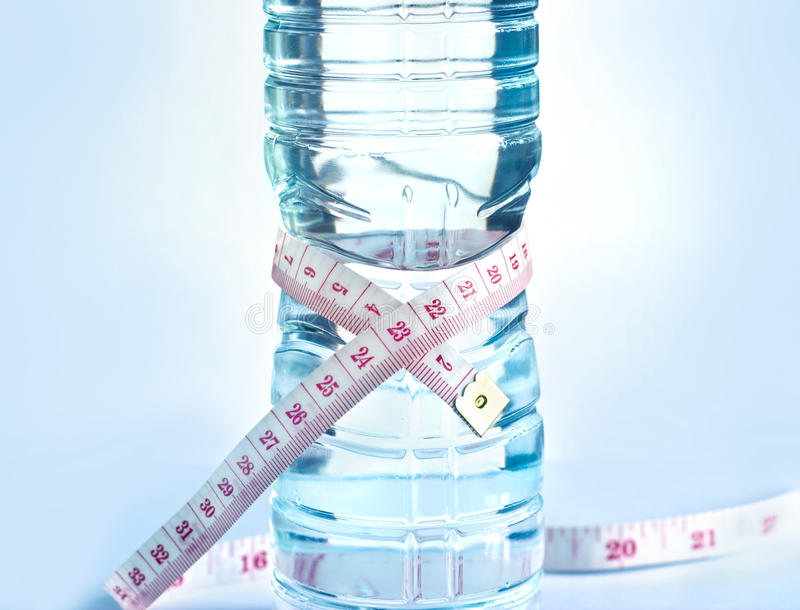 White measure on water bottle shape, healthy drink concept stock image