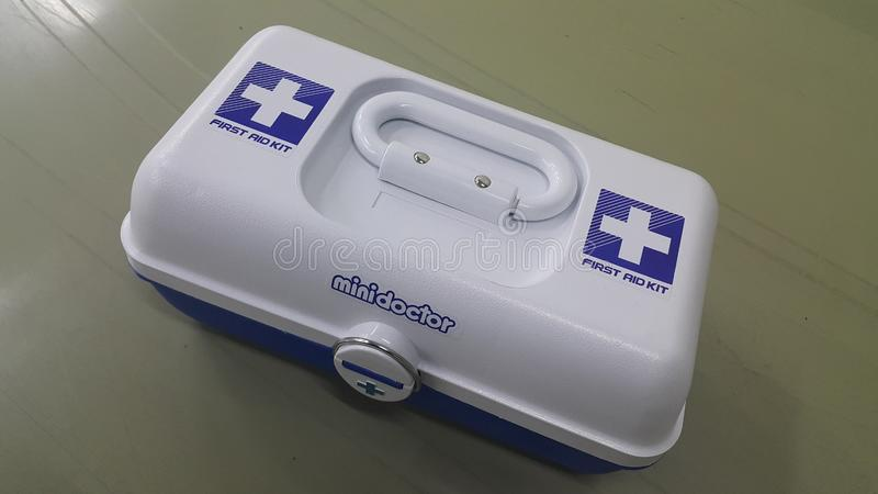 White medical box or first aid kit with plus or cross sign stock images