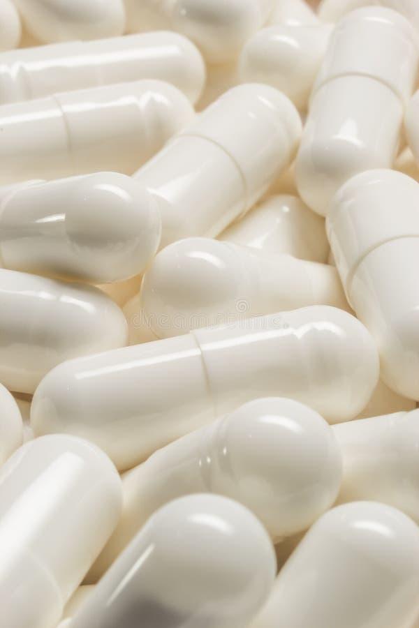 White Medical Capsules Macro Stock Photos