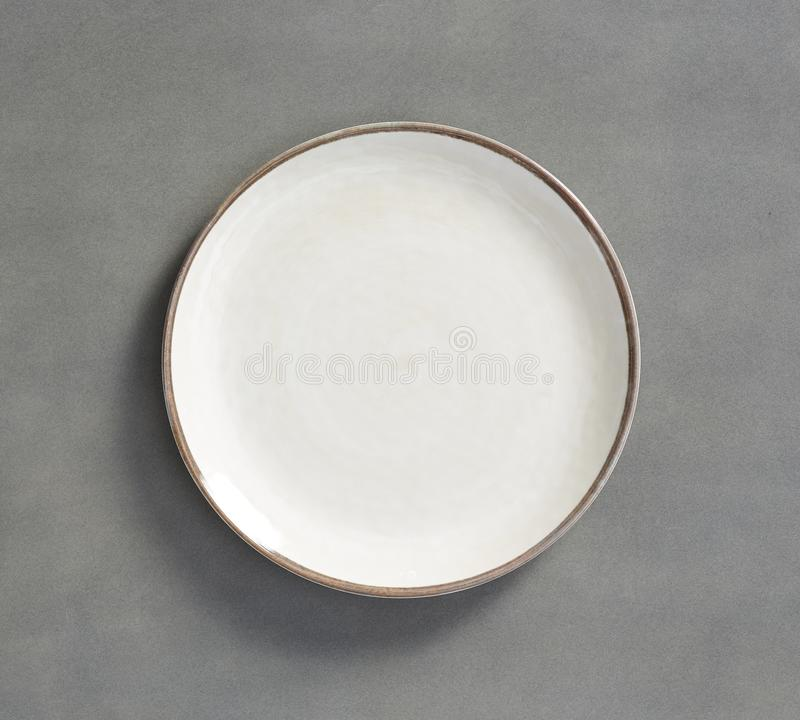 White Melamine Plate  with light gray background royalty free stock photos