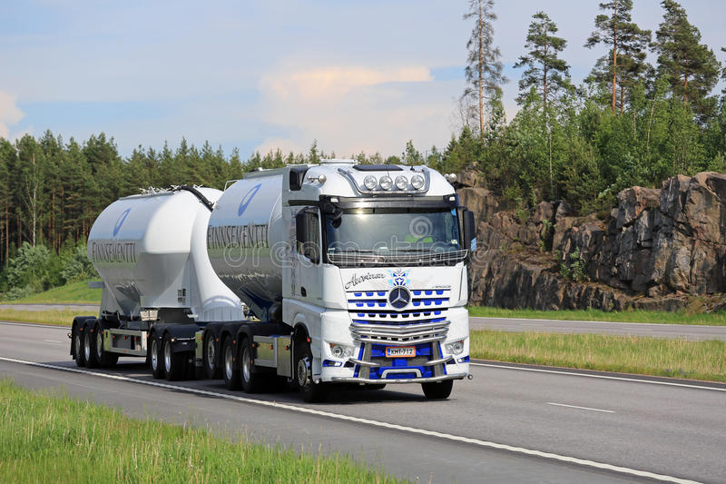 White Mercedes-Benz Arocs for Cement Haul. PAIMIO, FINLAND - JUNE 3, 2016: White Mercedes-Benz Arocs 3258L tank truck of Kuljetus Auvinen for cement haul on stock photography