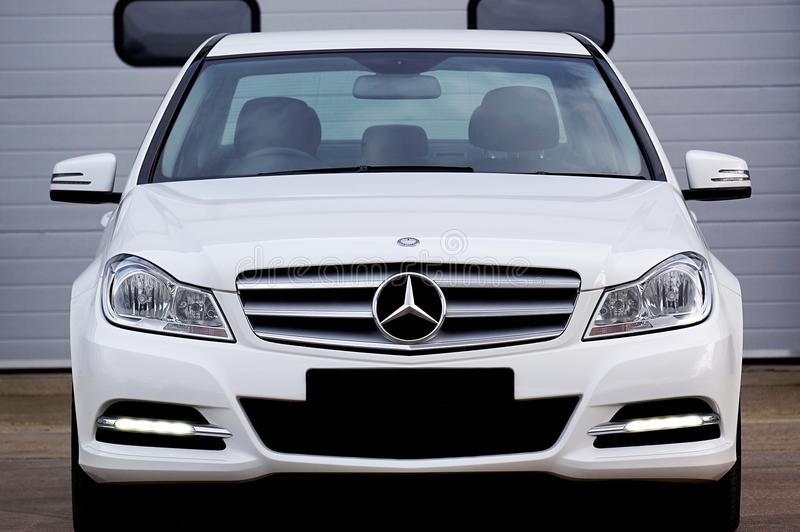 White Mercedes-benz Car Near Grey Building royalty free stock photo