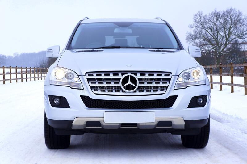White Mercedes Benz Car on White Snow Covered Ground at Daytime stock photo