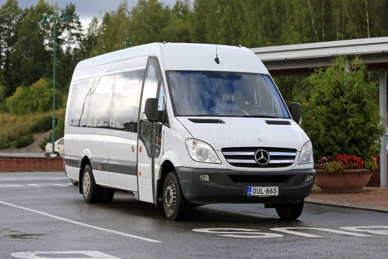 White Mercedes-Benz Sprinter Minibus stock images