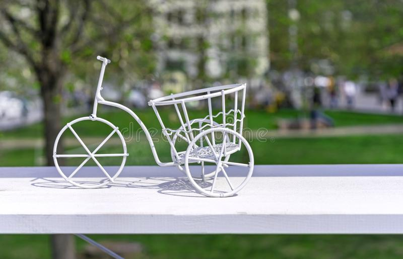 White metal bike. Flower stand in the form of a white metal bike.  royalty free stock photos
