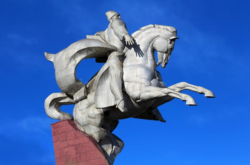 White metal monument mounted on a stone pedestal. Statue of the great commander sitting on a horse in full military uniform and ready to defend the Motherland stock image