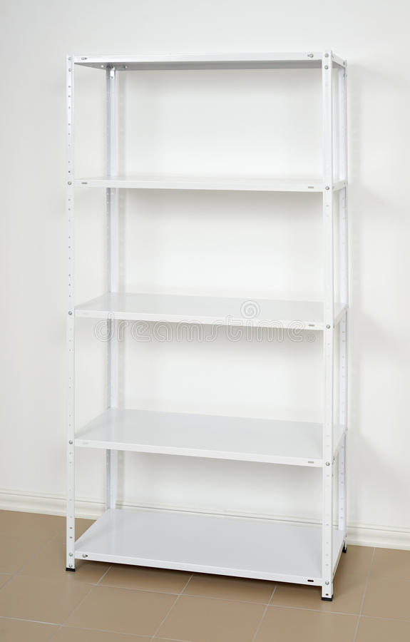 White metal rack near the wall, empty shelves stock images