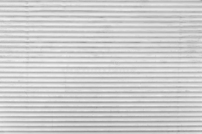 White metal roller door shutter background royalty free stock images
