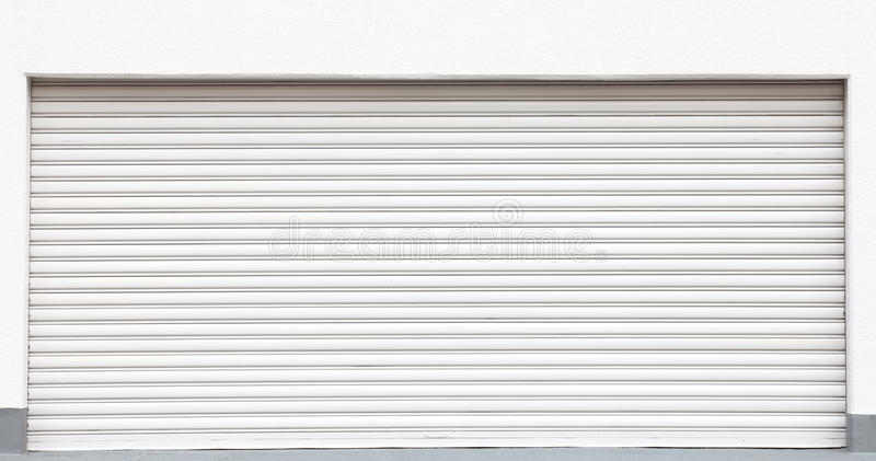 White metal shutters. Over a shop doors royalty free stock photography