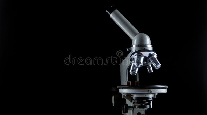white microscope on dark background. Close up royalty free stock image